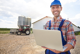 farmer holding laptop