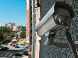 security camera mounted on side of bulding