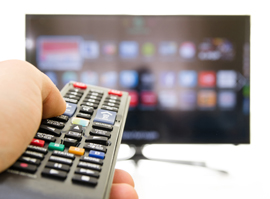 remote control pointed at smart tv