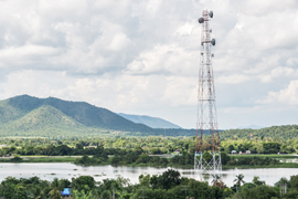 internet communications tower overlooking lake and mountains