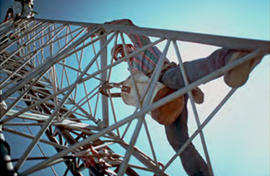 man climbing a network tower